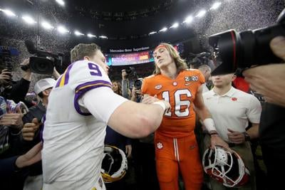 Louisiana State quarterback Joe Burrow (9) talks with Clemson quarterback Trevor Lawrence (16) after LSU's 42-25 victory in the College Football Playoff National Championship game at Mercedes Benz Superdome in New Orleans on Jan. 13, 2020.
