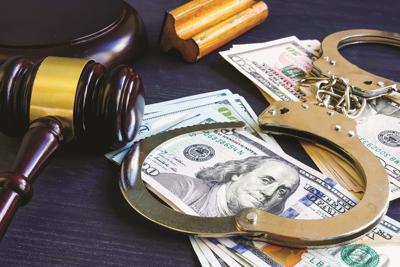 Money, handcuffs, gavel