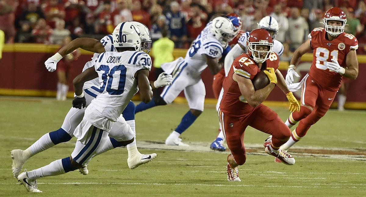 Kansas City Chiefs tight end Travis Kelce (87) turns up field as Indianapolis Colts defensive back George Odum (30) and Indianapolis Colts cornerback Quincy Wilson (31) pursue in the first half on Sunday, Oct. 6, 2019 at Arrowhead Stadium in Kansas City, Mo.