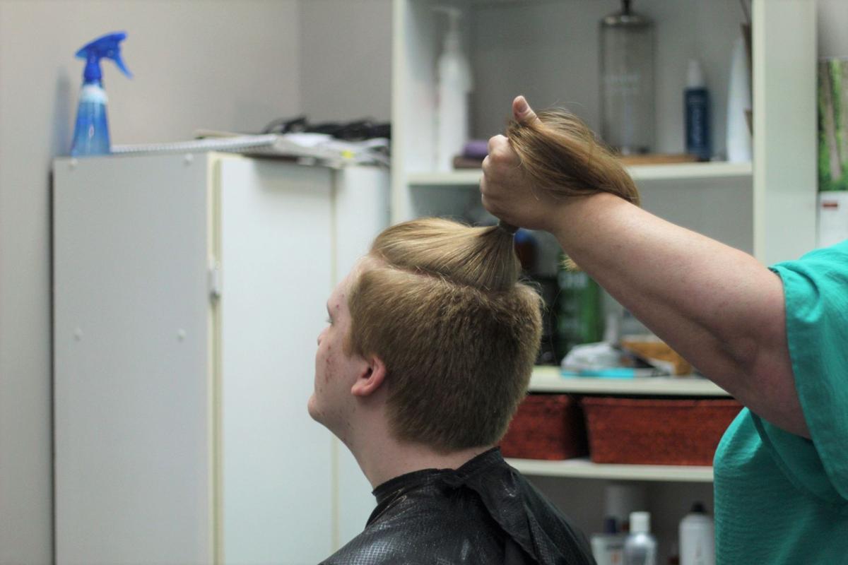 Noah getting his hair cut
