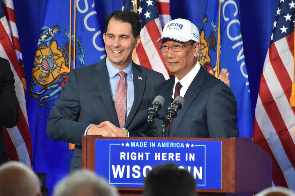 Gov. Scott Walker and Foxconn CEO Terry Gou shake hands