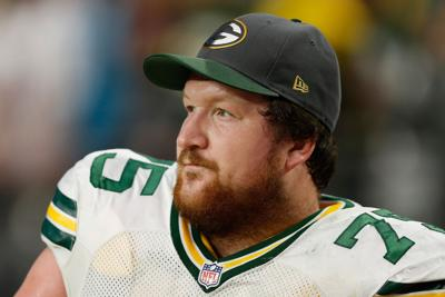 Tackle Bryan Bulaga #75 of the Green Bay Packers on the sidelines during the NFL game against the Arizona Cardinals at the University of Phoenix Stadium on Dec. 27, 2015 in Glendale, Ariz.