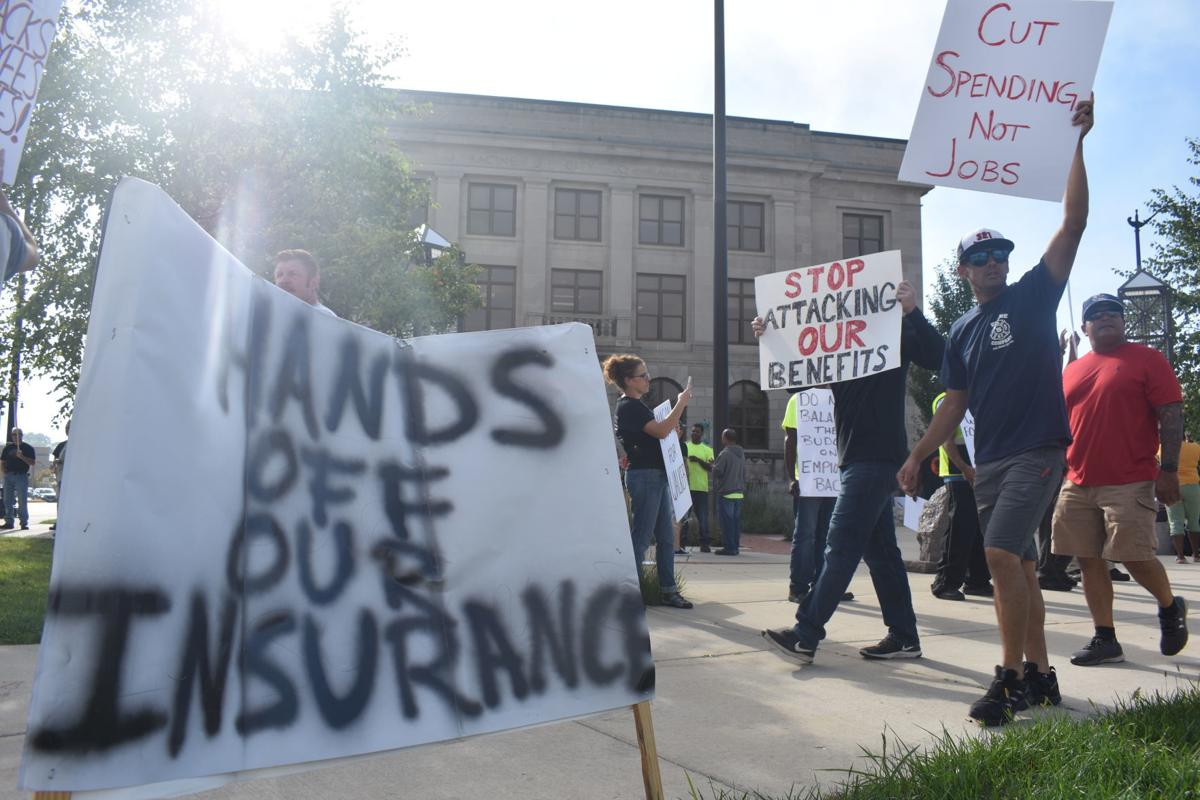City employees march on health care issues