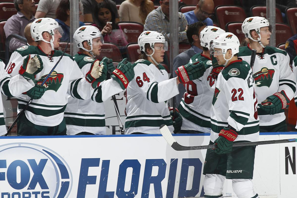 Nino Niederreiter #22 of the Minnesota Wild is congratulated by teammates after scoring a first-period goal against the Florida Panthers at the BB&T Center on November 24, 2014, in Sunrise, FL..