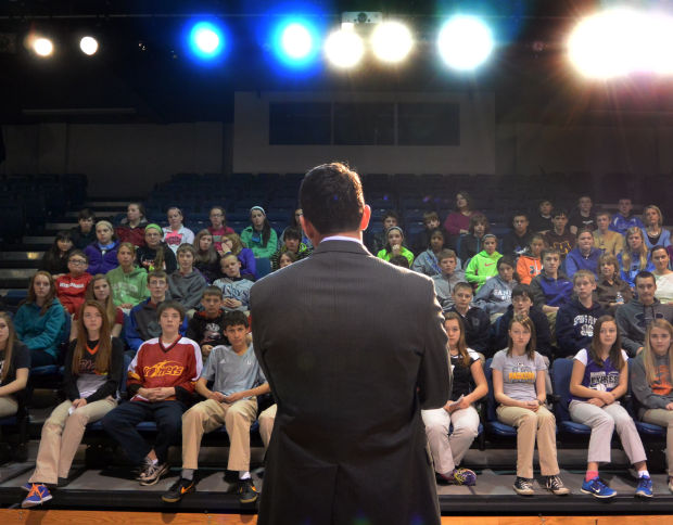 U.S. Rep. Paul Ryan (R-Janesville) answers questions from the students Monday, March 31, 2014, at St. Mary's Grade School in Burlington. Ryan came to talk to the students from St. Mary's and St. Charles Borromeo School, after the student's trip to Washington. D.C., was delayed by the government shutdown this past fall. Photo by Gregory Shaver, Racine Journal Times