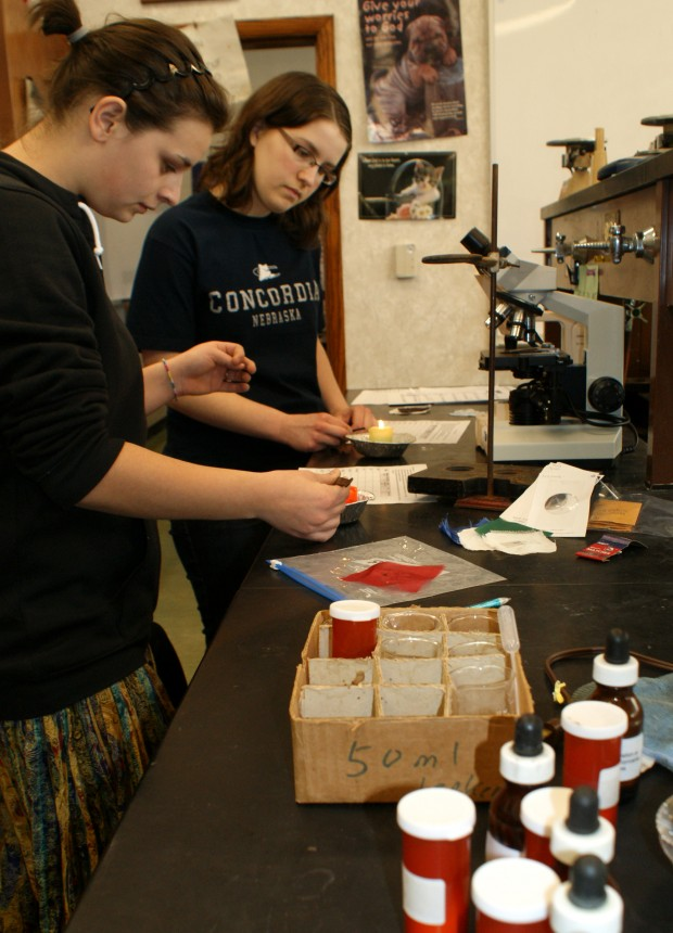High School students investigate evidence in forensic science classHigh School Science Class