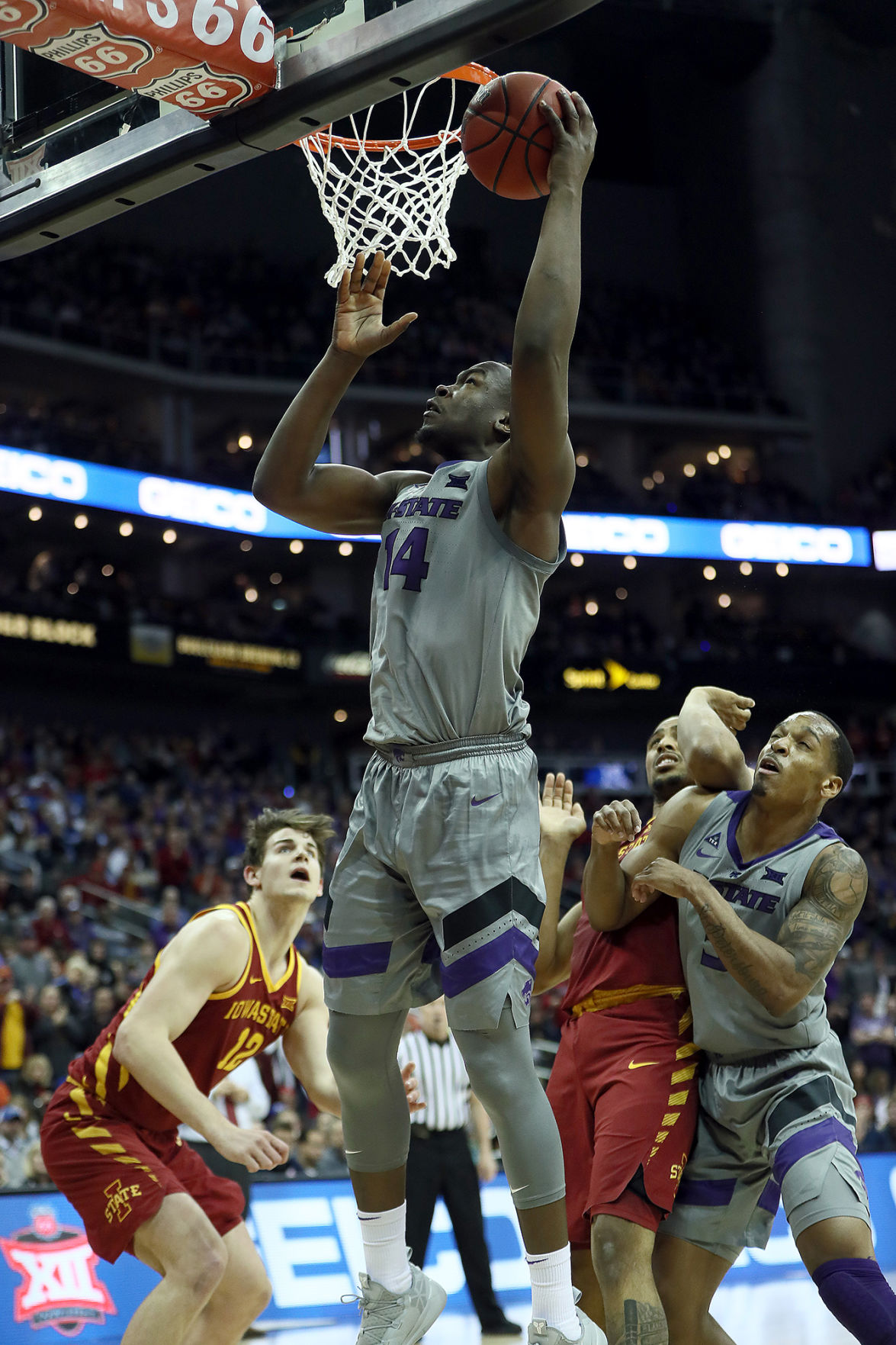 Kansas State's Levi Stockard III (34) lays up a shot against Iowa State during the semifinals of the Big 12 Tournament at Sprint Center in Kansas City, Mo., on March 15, 2019. Iowa State advanced, 63-59. **FOR USE WITH THIS STORY ONLY**