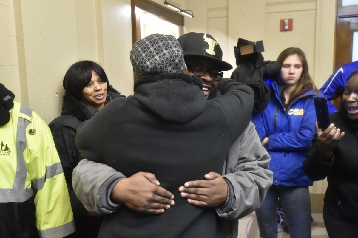 Geneva Reed-Veal hugs Nakia Shannon at rally