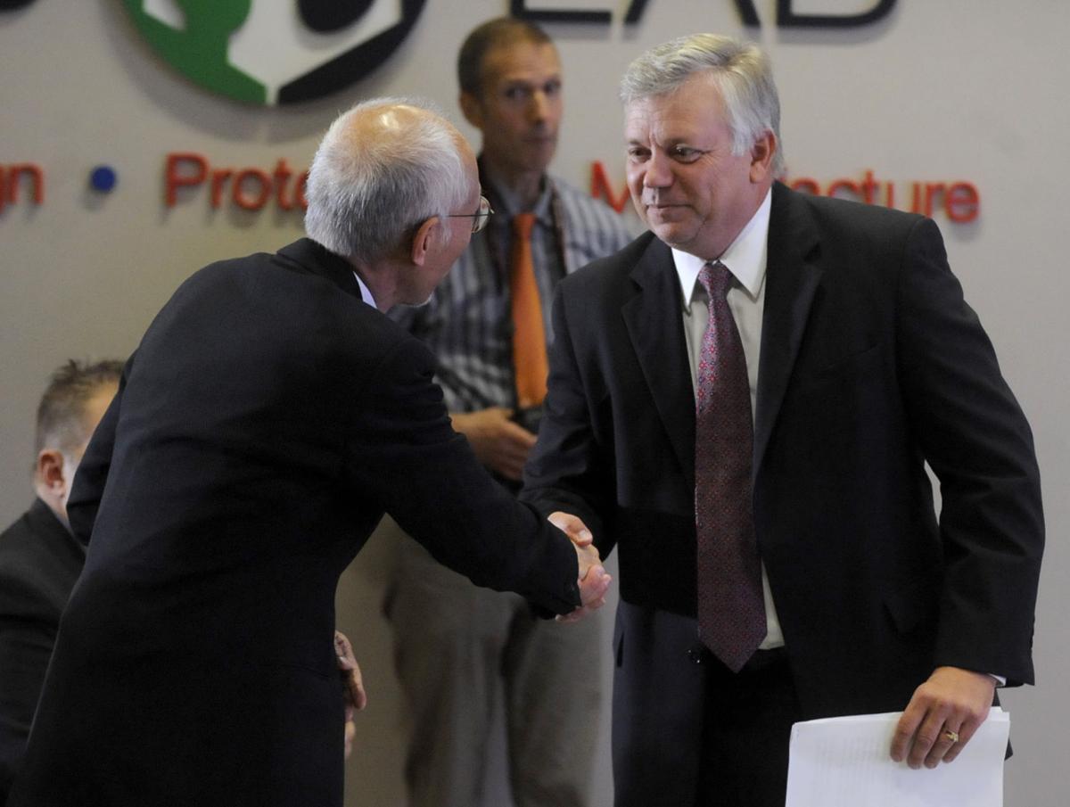 DeGroot and Woo shake hands