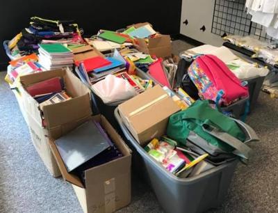 Karate School students donate school supplies