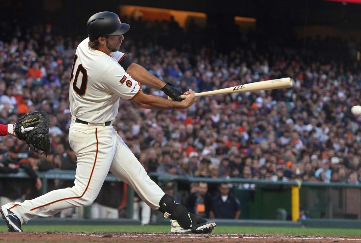 Madison Bumgarner (40) of the San Francisco Giants gets a base hit against the Philadelphia Phillies in the bottom of the third inning on Aug. 8, 2019 at Oracle Park in San Francisco, Calif.