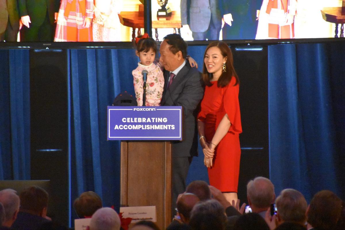 Terry Gou with wife and child