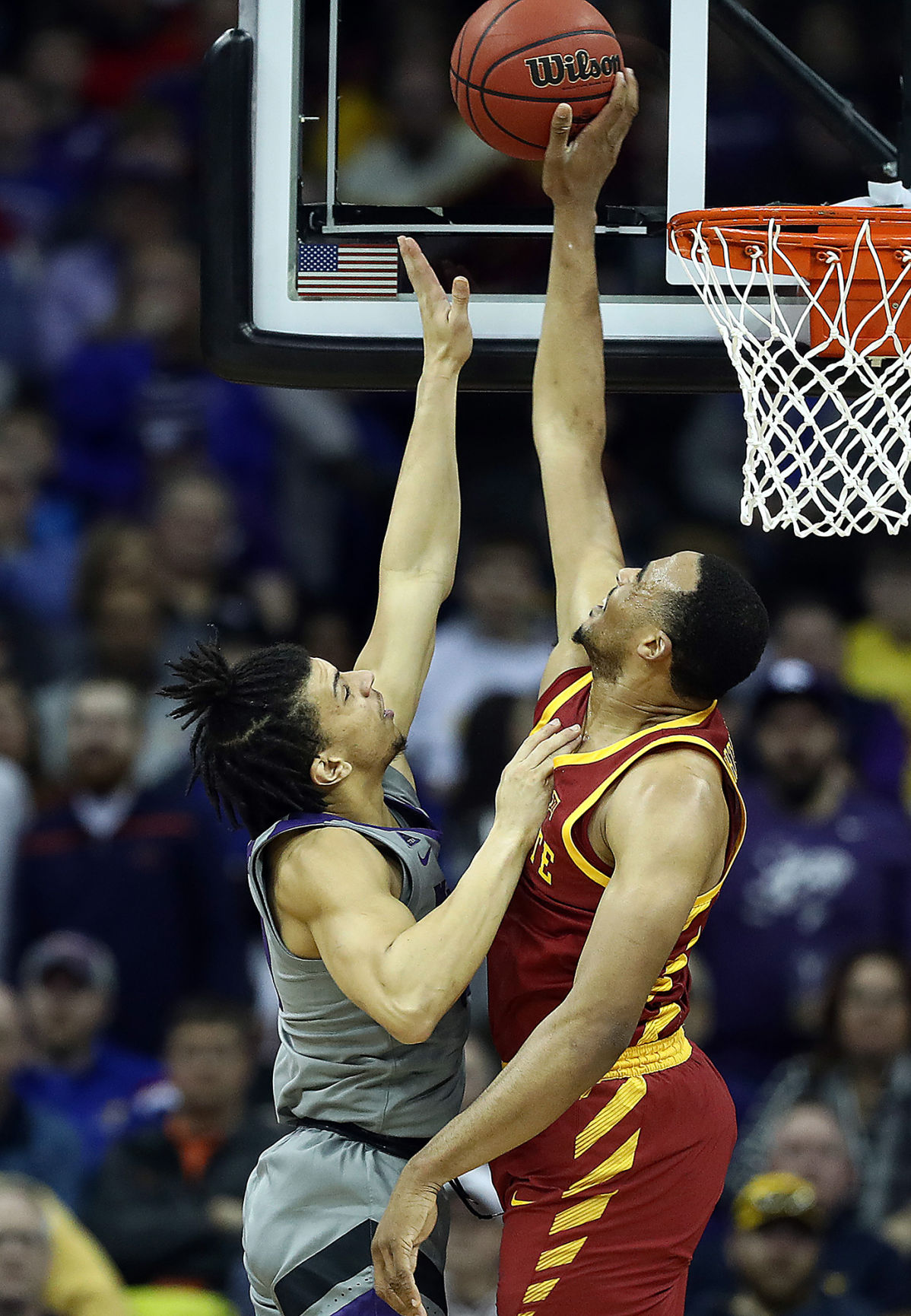 Iowa State's Talen Horton-Tucker, right, blocks a shot by Kansas State's Mike McGuirl during the semifinals of the Big 12 Tournament at Sprint Center in Kansas City, Mo., on March 15, 2019. Iowa State advanced, 63-59. **FOR USE WITH THIS STORY ONLY**
