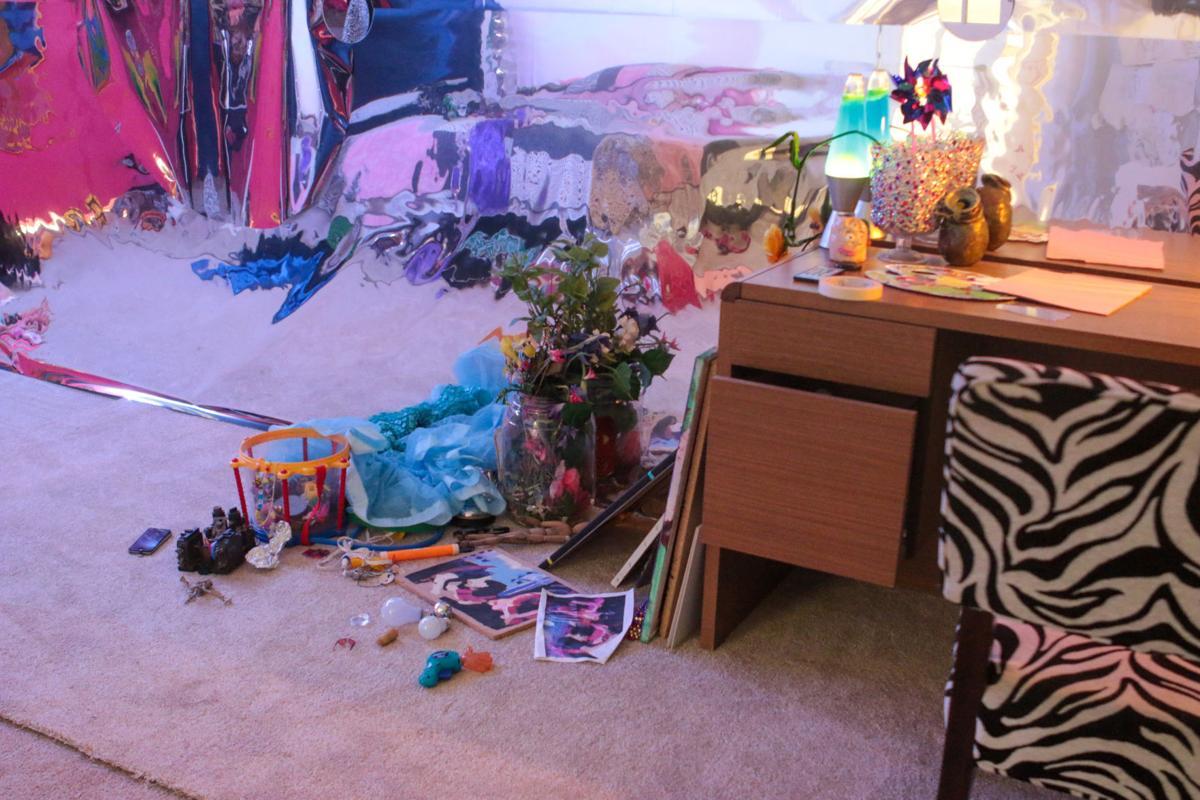 "Household items cover the floor in the ""Dizzzybomb"" exhibit"