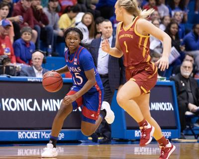 Zakiyah Franklin dribble the ball near the sideline as an Iowa State guard runs in front of her