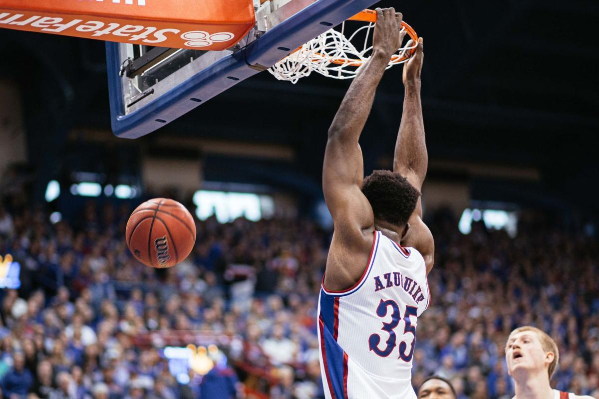 Udoka Azubuike hangs onto the basket as he dunks the ball