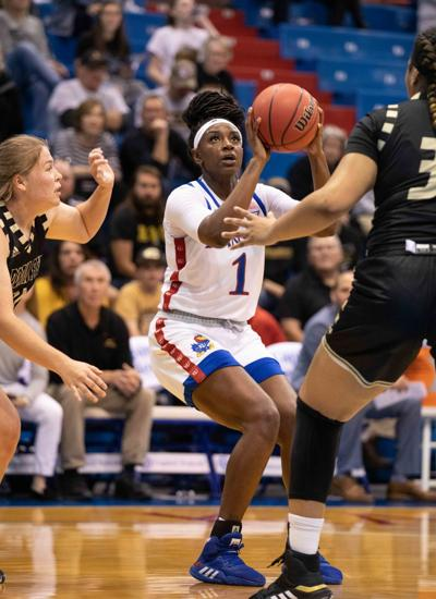 Junior forward Tina Stephens shoots the basketball in a game against Emporia in Allen Fieldhouse