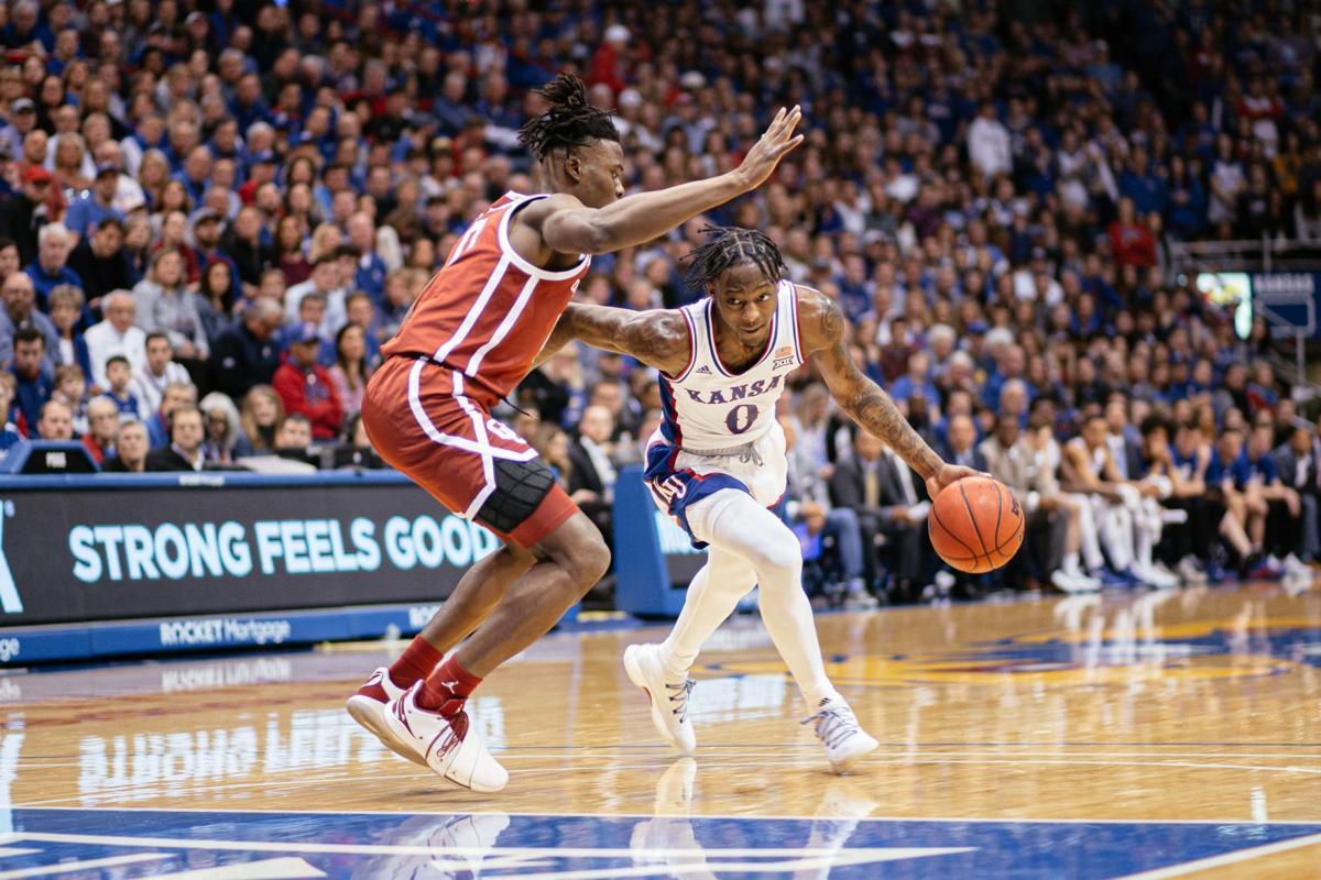 Marcus Garrett drives the ball as an Oklahoma guard tries to block him