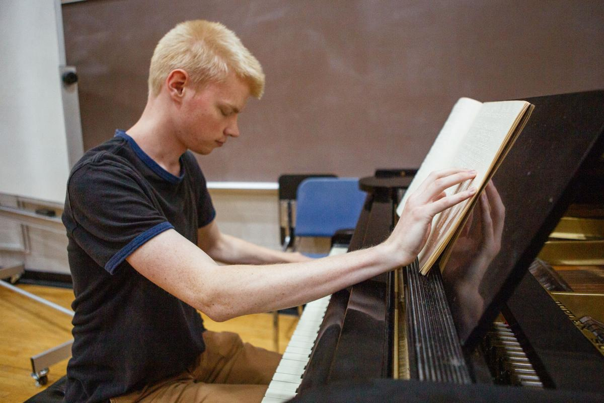 Sophomore Luther Fuller reads braille music as he plays the piano