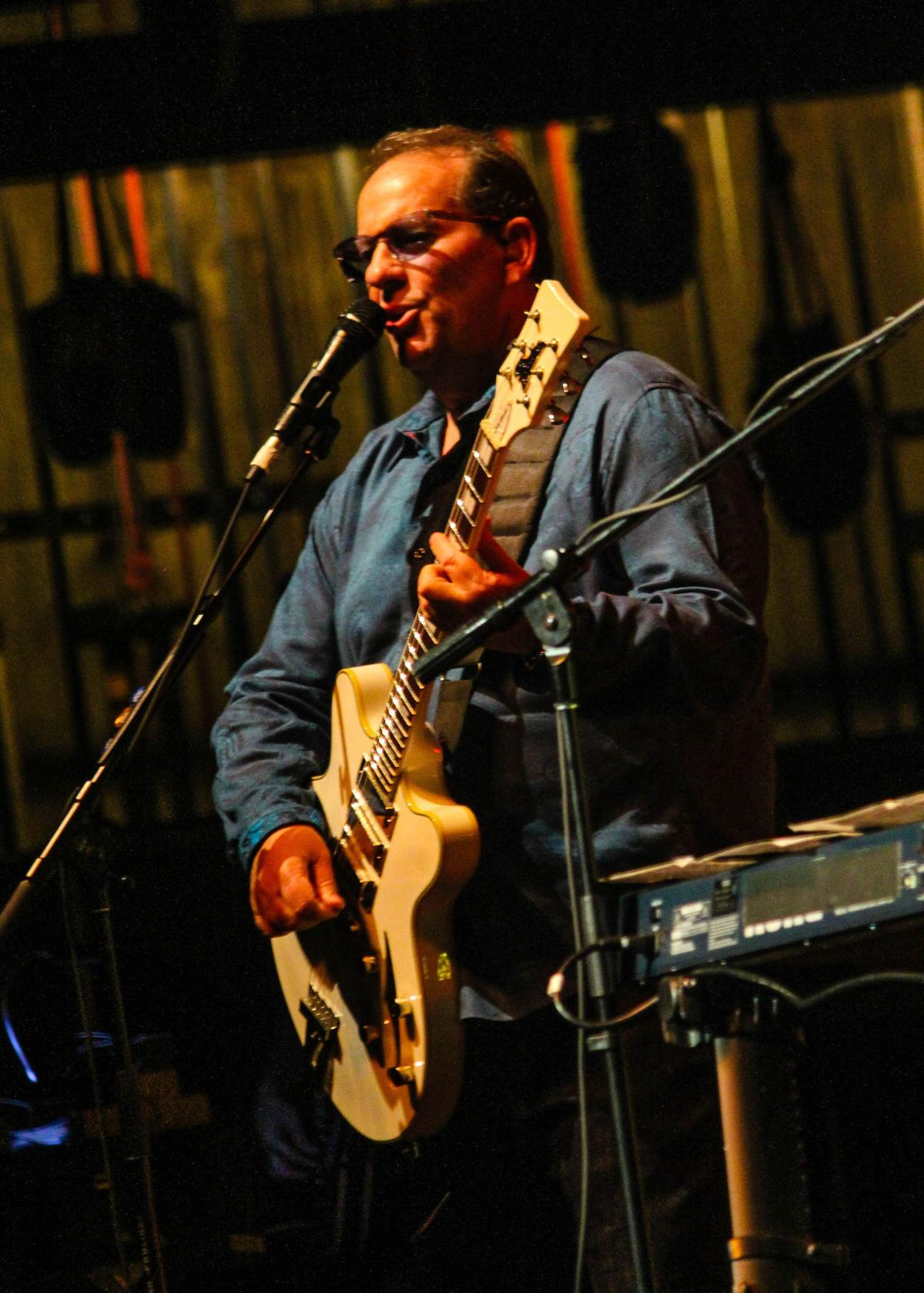 Jeffrey Foskett plays the rhythm guitar with the Beach Boys who performed at the Lied Center on April 19 in front of a full house