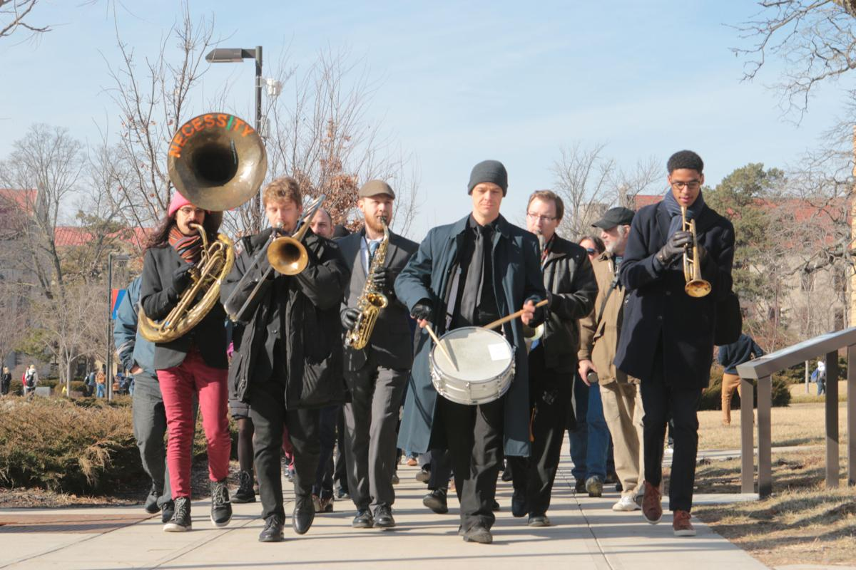 A marching band plays walking toward the Kansas Union for the Martin Luther King Jr. March Across Campus.