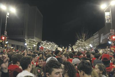 K.U. students and Lawrence locals storm Massachusetts Street after the Kansas City Chiefs won the Super Bowl