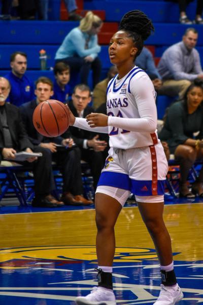 K.U. sophomore guard Brooklyn Mitchell dribbles a basketball in Allen Fieldhouse