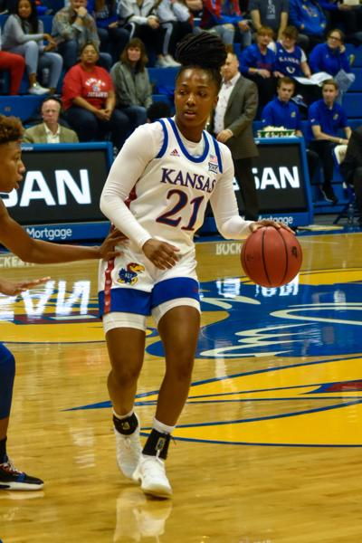 Sophomore guard Brooklyn Mitchell dribbles the ball on the court of Allen Fieldhouse