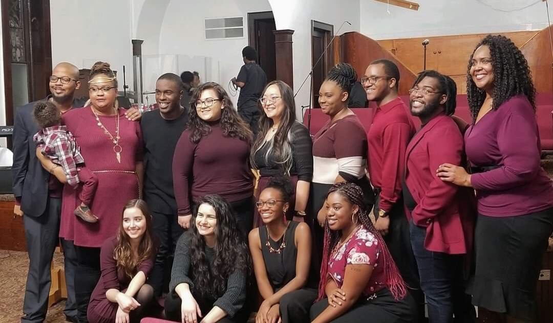 University of Kansas Inspirational Gospel Voices stand together