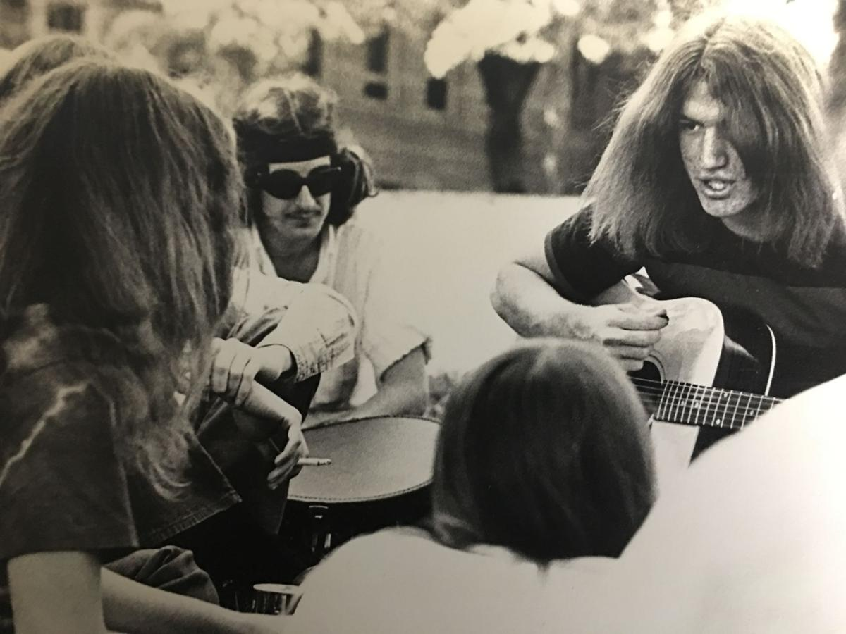 KU students playing guitars at a protest