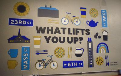 "A board reads ""What lifts you up?"""