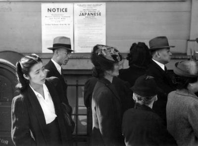 Japanese Americans stand in line awaiting orders related to internment
