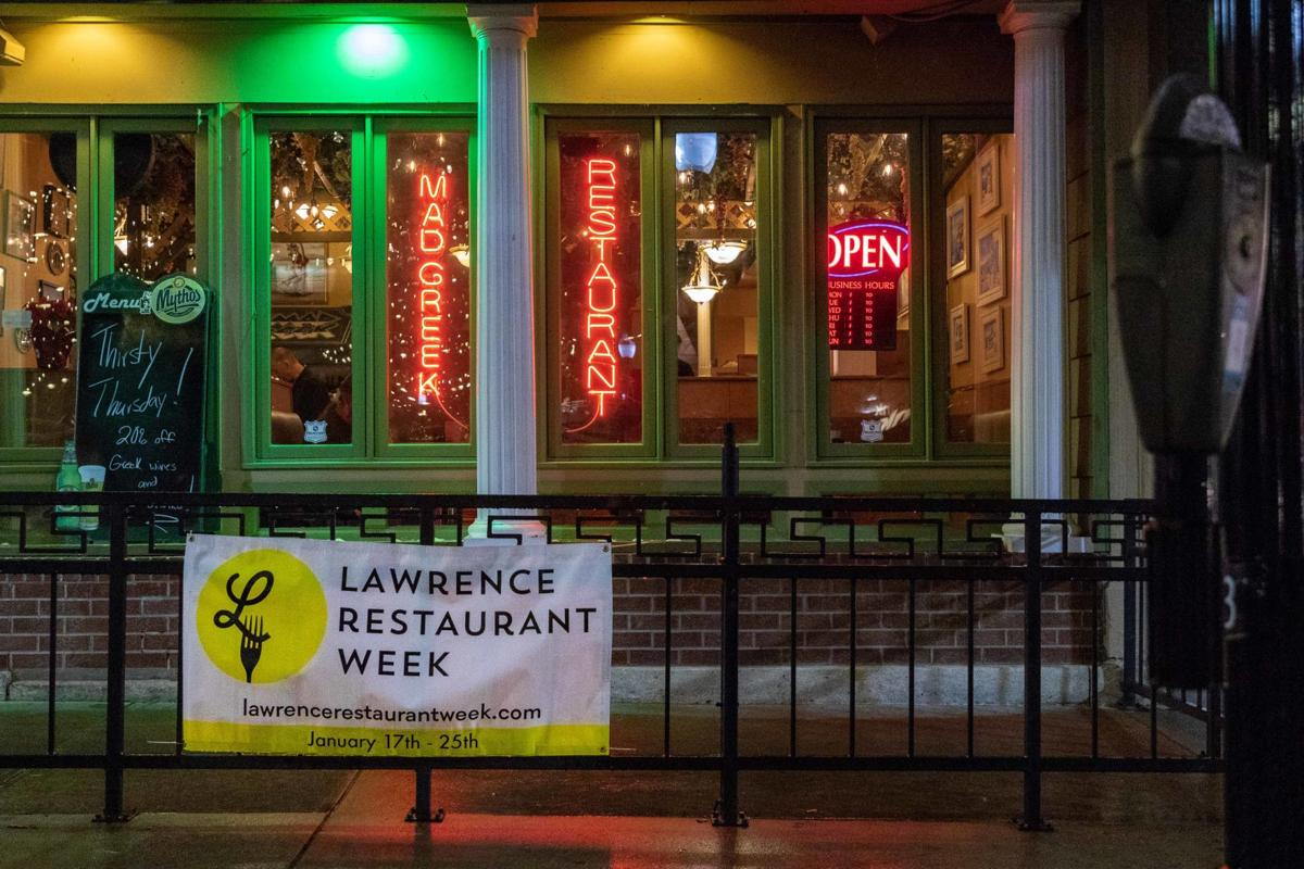 """A sign reads """"Lawrence Restaurant Week"""" and hangs outside of The Mad Greek"""