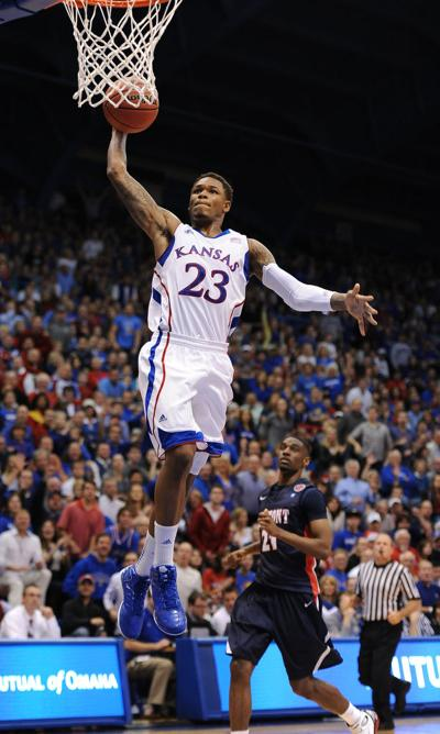 Ben McLemore jumps to the net as he goes to dunk the basketball in Allen Fieldhouse