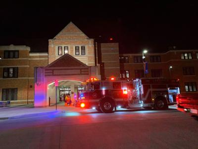 A fire truck has its lights on outside the Kansas Union