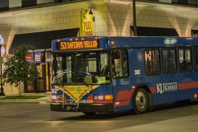 A K.U. SafeRide bus drives down Massachusetts Street