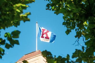 KU flag stands atop a building