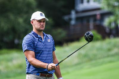 Luke Kluver holds his driver extended in front of him