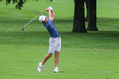 Ben Sigel follows through on his swing on the course in the Windon Memorial Classic