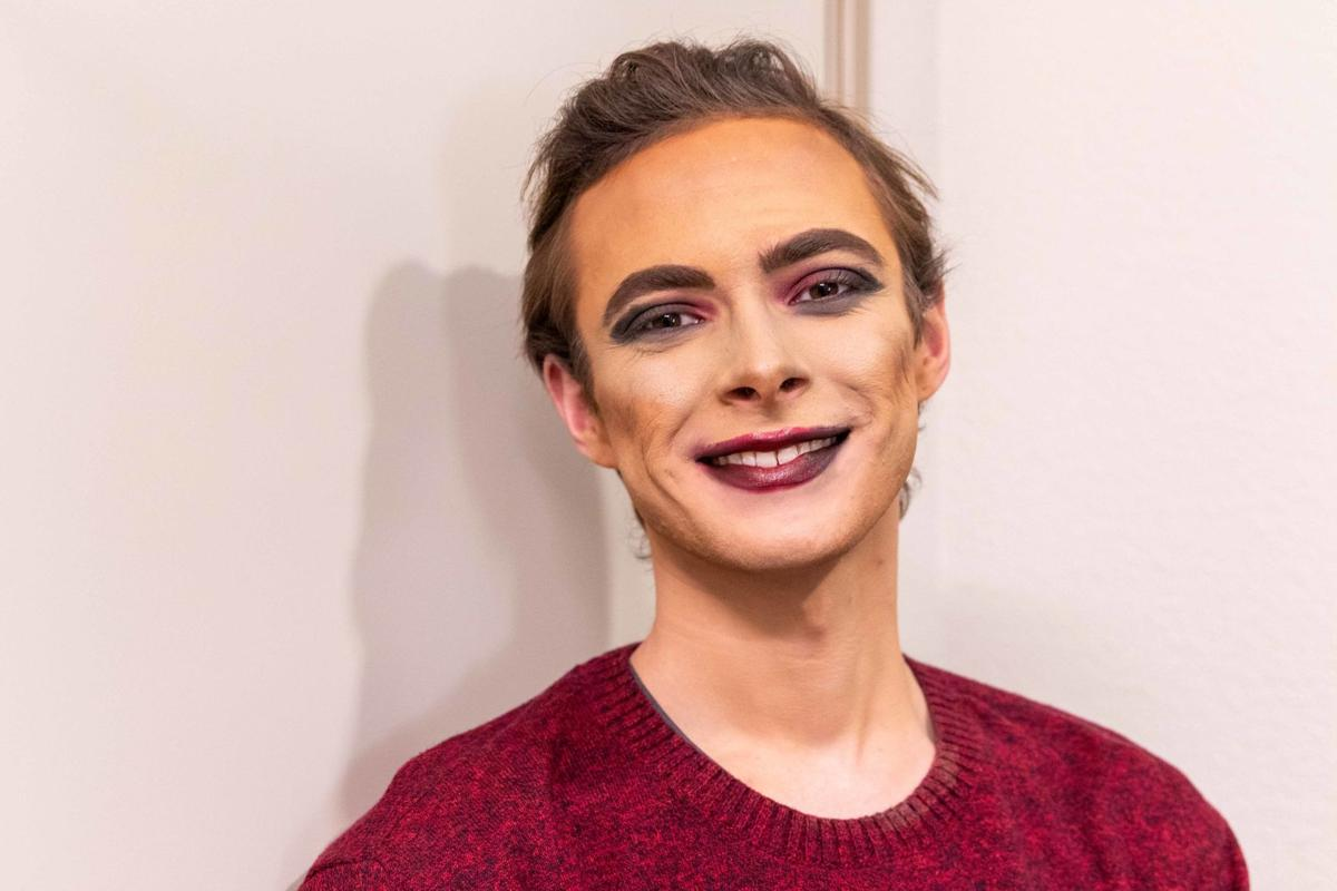 Sophomore Derek Dunn poses for a photo in a full face of drag makeup