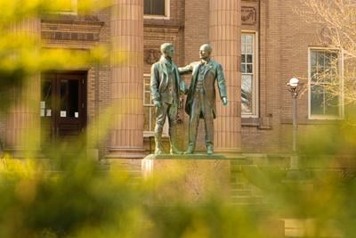 The Lippincott statue is seen through bush branches (copy) (copy)