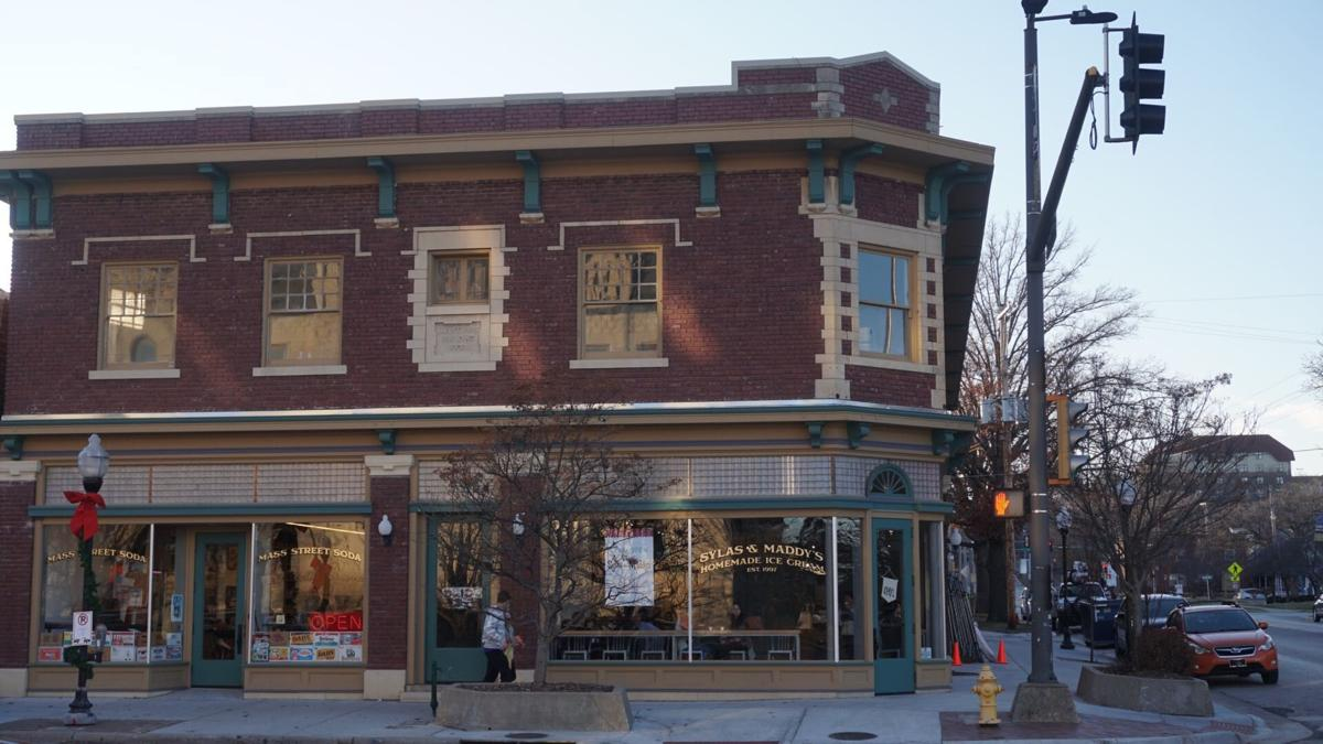 The corner building shows Sylas and Maddy's ice cream shop next to Mass Street Soda.