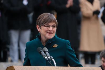 Laura Kelly speaks at a podium