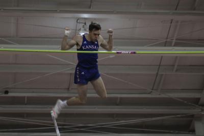 Sophomore Zach Bradford hurls himself mid-air over the bar at a pole vault event