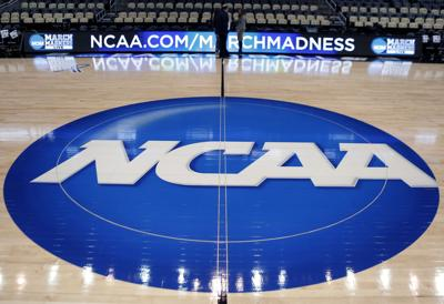 The NCAA logo decorates the basketball court