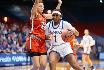 Junior forward Tina Stephens tries to dribble towards the basket.