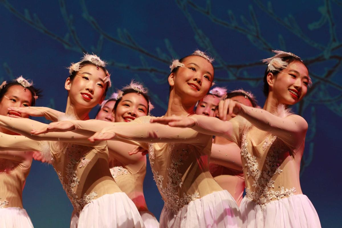 A group of women dances on stage at a Lunar New Year's celebration