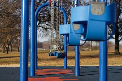 Empty swing set broken arrow park