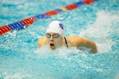 Sophomore Greta Olsen pokes her head above the water to breathe as she swims in the 200-yard butterfly