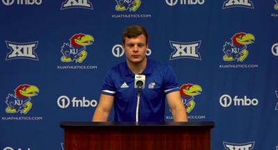 Nick Channel takes the stand at a football media availability 10/12
